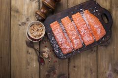 Salmon steaks with large salt, lemon and spices. Preparation of tasty and healthy food. Place for text. Seafood. Healthy food.  Royalty Free Stock Image