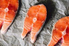 Salmon Steaks on Parchment Paper. Raw Salmon Steaks on Parchment Paper. View frrom Above Stock Images
