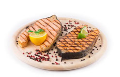 Salmon steaks on platter Royalty Free Stock Photos