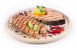 Salmon steaks on platter. Royalty Free Stock Image