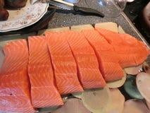 Salmon steaks and scallops Stock Photos