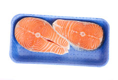 Salmon steaks in tray Royalty Free Stock Images