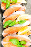 Salmon on stone with basil and lemon Royalty Free Stock Photography