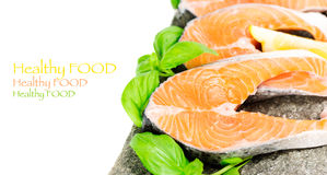 Salmon on stone with basil and lemon isolated, copy space Stock Images
