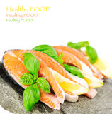 Salmon on stone with basil and lemon isolated on white Stock Photography