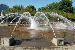 Salmon Street Fountain in Portland, Oregon. The Salmon Street Fountain in Portland, Oregon on Tom McCall Waterfront Park is a favorite place to cool off on a hot royalty free stock images