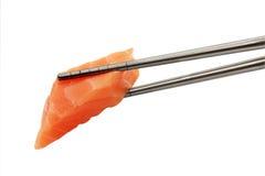 Salmon Sushi. With chopsticks shot on white Stock Images