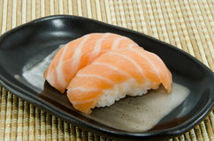 Salmon sushi. On black plate Royalty Free Stock Image