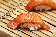 Salmon sushi on a bamboo tray Stock Image
