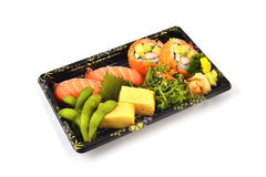 Salmon Sushi and California Maki  and Tamoko tamago fill with Pigeon pea and spicy Seaweed salad Japanese tradition food in delive Royalty Free Stock Photography
