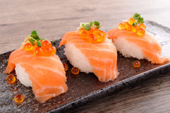 Salmon sushi with caviar Stock Images