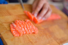 Salmon Sushi. Chef slice salmon prepare for make the sushi. Japanese food royalty free stock photography