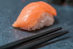 Salmon sushi with chopsticks Stock Photography