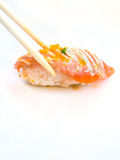Salmon sushi with chopsticks Royalty Free Stock Photo