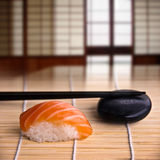 Salmon sushi and chopsticks, japanese interior Stock Photo