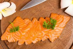 Salmon sushi on cutting board with flower on wood color pink clo. Seup stock photos