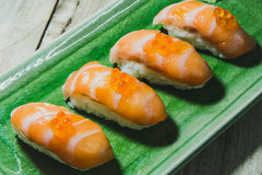 Salmon sushi. Salmon sushi with ikura on green plate Stock Photo