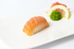 Salmon sushi with lemon, ginger and wasabi Stock Photos