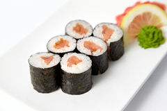Salmon sushi with lemon, ginger and wasabi Stock Photography