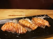 Salmon Sushi with a little burn on top, raw food, traditional Japanese food Stock Images