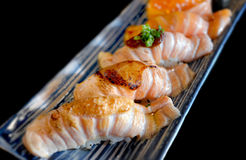 Salmon sushi with little grill cooking. stock images