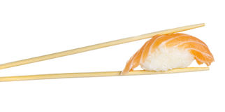 Salmon sushi nigiri sushi roll in chopsticks isolated Stock Photography