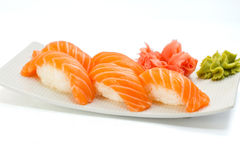 Salmon sushi nigiri on white plate and background Royalty Free Stock Photography