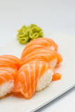 Salmon sushi nigiri on white plate and background Stock Images
