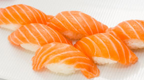 Salmon sushi nigiri on white plate and background Royalty Free Stock Image