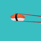 Salmon sushi with red chopsticks. On blue Royalty Free Stock Image