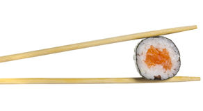 Salmon sushi roll in chopsticks isolated Royalty Free Stock Image