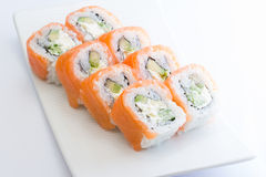 Salmon sushi roll. Philadelphia sushi roll with salmon l cucumber and cheese royalty free stock photo