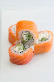 Salmon sushi roll. Philadelphia sushi roll with salmon l cucumber and cheese royalty free stock images