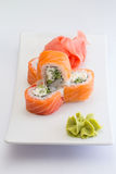 Salmon sushi roll. Philadelphia sushi roll with salmon l cucumber and cheese royalty free stock image