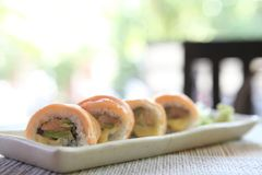 Salmon sushi rolls. On a plate royalty free stock images