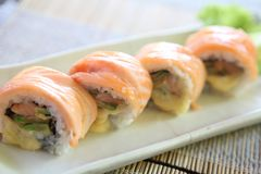 Salmon sushi rolls. On a plate royalty free stock image