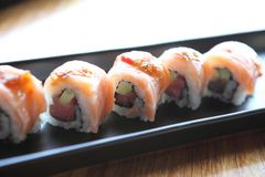 Salmon sushi rolls. On a plate stock images