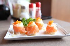 Salmon sushi rolls, Japanese food. Salmon sushi rolls on a plate royalty free stock image
