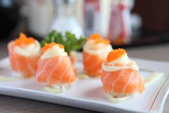 Salmon sushi rolls, Japanese food. Salmon sushi rolls in close up royalty free stock images