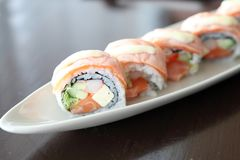 Salmon sushi rolls, Japanese food. Salmon sushi rolls on a plate royalty free stock photography