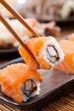 Salmon sushi rolls. Japanese food stock image