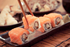 Salmon sushi rolls. Japanese food-Filtered Image stock images