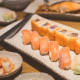Salmon sushi rolls Stock Images