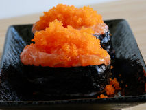 Salmon sushi rolls with shrimp eggs on top, Japanease foood. Close up salmon sushi rolls with shrimp eggs on top, Japanease foood Stock Photos