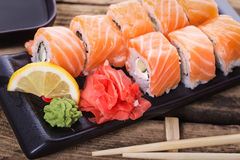 Salmon sushi rolls. On a wooden background royalty free stock photos