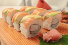 Salmon sushi rolls. On a wooden plate Stock Photos