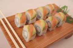 Salmon sushi rolls. On wooden plate Stock Photo