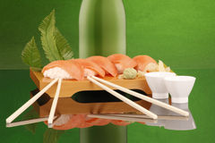 Salmon sushi and sake for 2 Stock Photography
