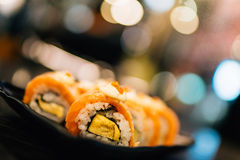 Salmon sushi or salmon roll, beautiful blur bokeh background, depth of field effect Stock Photography