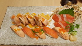 Salmon sushi and sashimi set. On dish. Japaness food Royalty Free Stock Photo